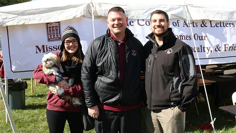 Alumni couple with College of Arts and Letters dean Shawn Wahl at homecoming.