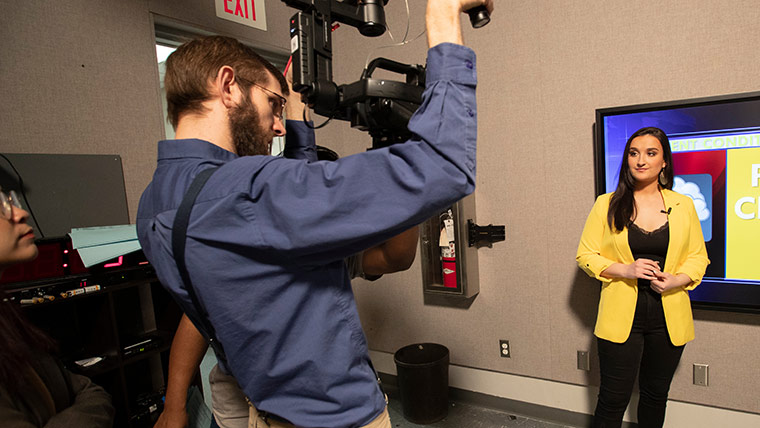 Student cameraman filming on-air weather anchor during Ozarks News Brief webcast.