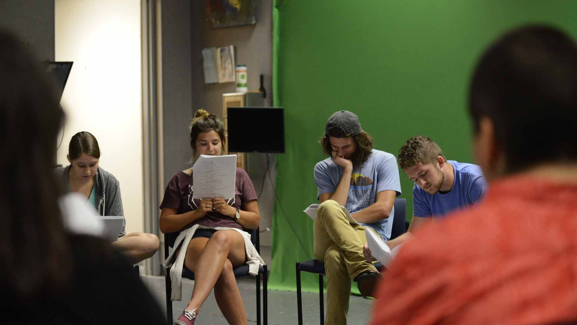 Students reading scripts.