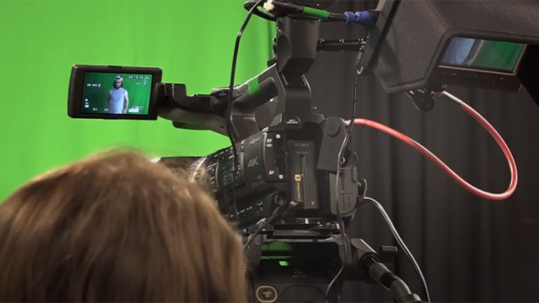 Filming on a green screen.